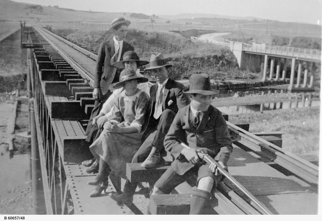 People on railway bridge