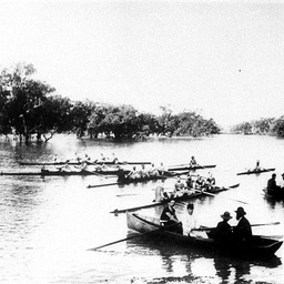 Wilcannia Rowing Club boats on the water with onlookers