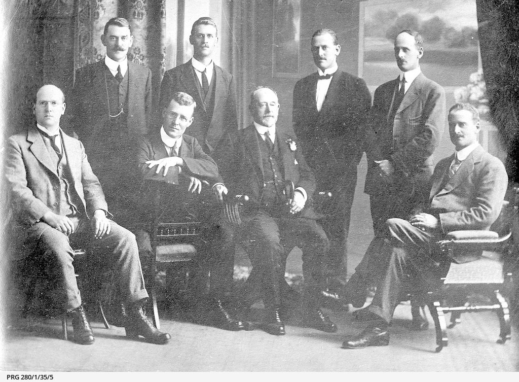 Arthur Searcy sitting with his seven sons
