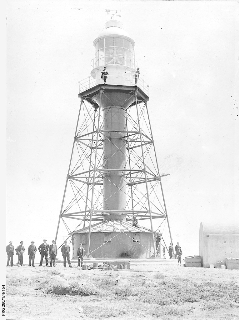 Visitors from the South Australian Marine Board standing at the base of Neptune Island lighthouse