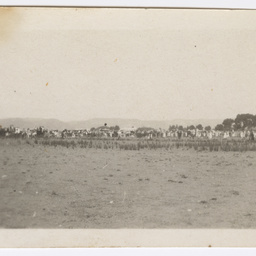 Crowds gathered at an airfield awaiting the Vickers Vimy G-EAOU.
