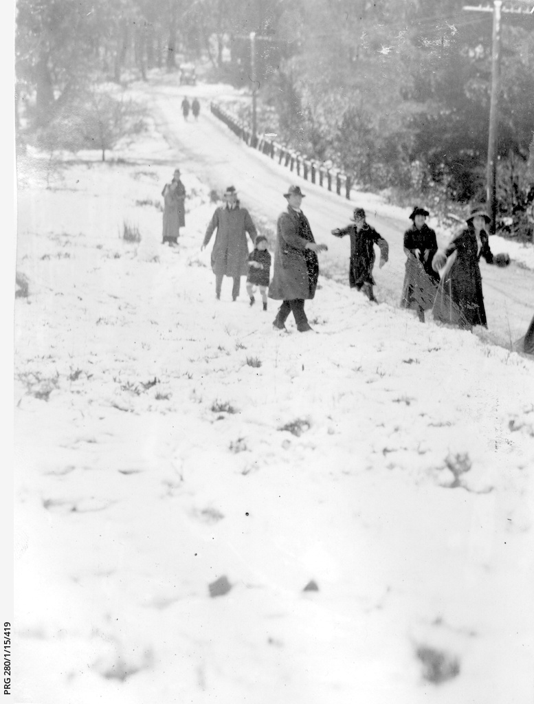 Walkers enjoying snow in the Mount Lofty Ranges, South Australia
