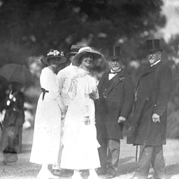 Guests meet for a chat at a garden party