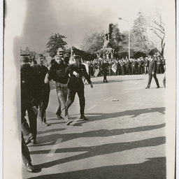 Policemen escorting a protester at the Vietnam War Moratorium rally