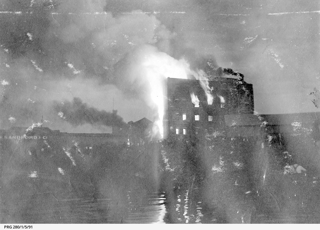 A night photograph of mills on fire at Port Adelaide in 1905