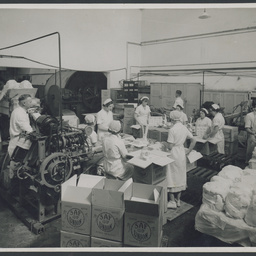 Packing butter at SA Farmers' Co-Op Union Ltd. Dairy Produce Department