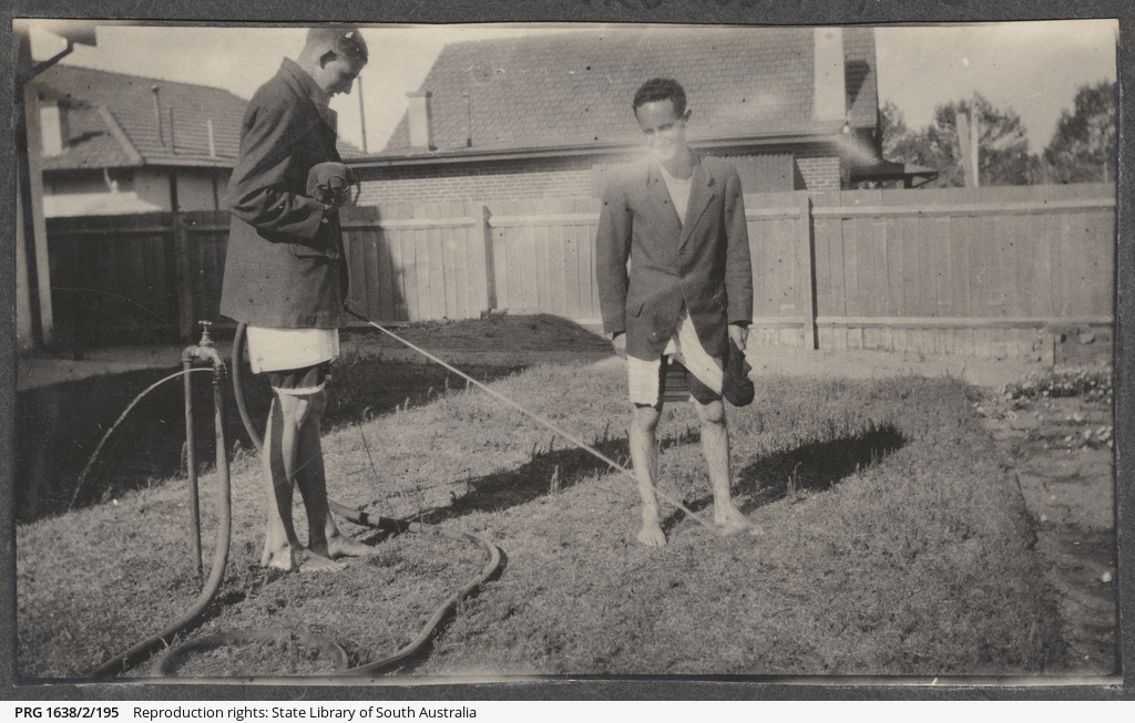 Two men washing feet