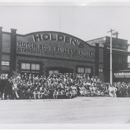 Staff outside Holden's Motor Body Builders Limited premises