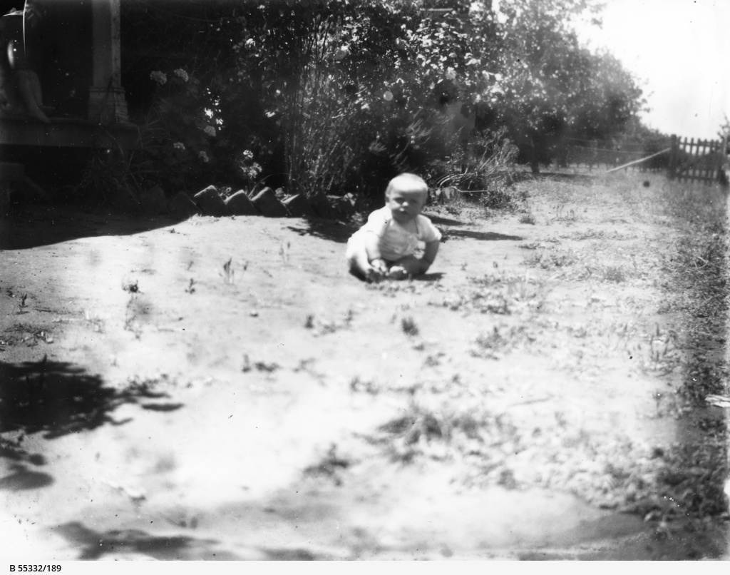 Young child playing in the garden