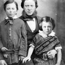 John Searcy of Hyde Park Square, London, with his two young sons Arthur John (left) and Algernon