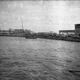 Troopships at a port.