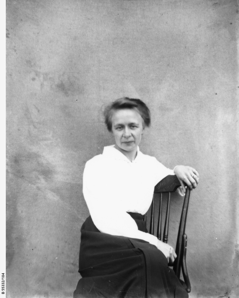 A woman seated on a chair