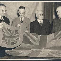 Group of men examining Sturt's flag