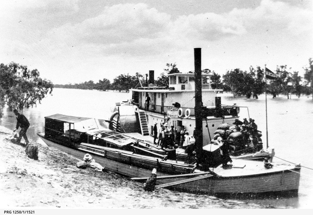 P.S. Queen with cargo and passengers alongside P.S. Jane Eliza in high river near Mildura