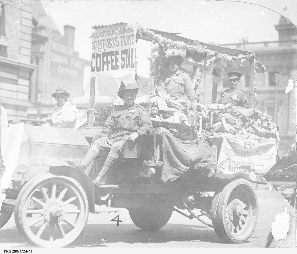 Soldiers riding on a decorated truck