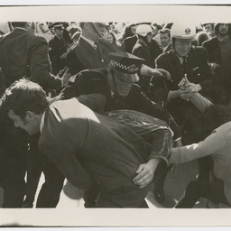 Police wrestling with protesters at the Vietnam War Moratorium rally