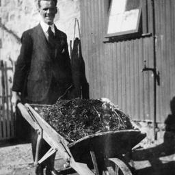 Man wheeling a barrow