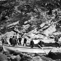 A party of visitors, including A. Searcy, taken by rowing boat to Harveys Return on Cape Borda