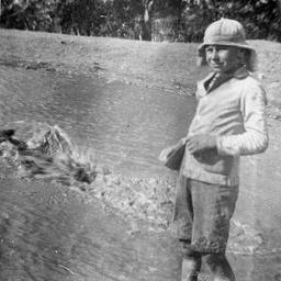 Boy standing in a creek