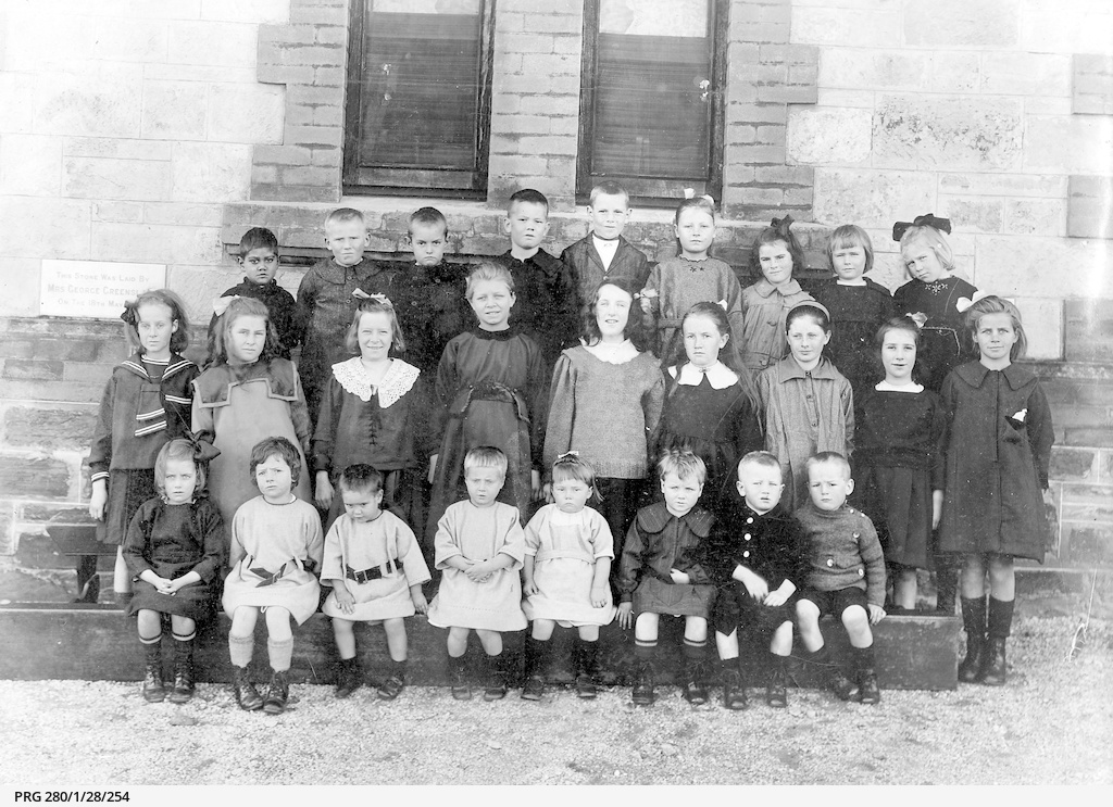 A group of children outside Magill Orphans Home