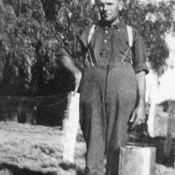 Young man carrying a kerosene can