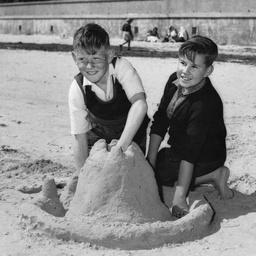 Boys building a sandcastle