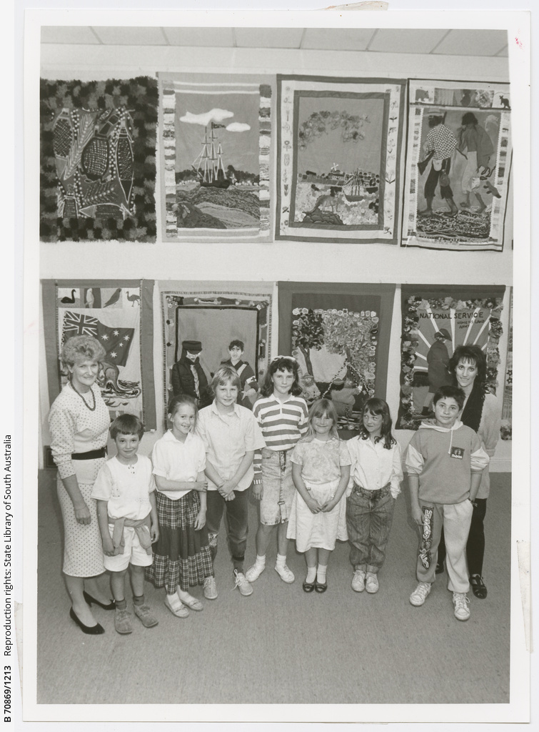 North Adelaide Primary School students Sam, Katherine, Sine, Jennifer, Tim, Miranda and Viktoria with teachers Jan Raftery(teacher) and Evelynne Richardson(art teacher) and the set of historic wallhangings that students stitched, darned and glued to create a colourful collection showing 12 stages in Australian history. 5th October 1988.