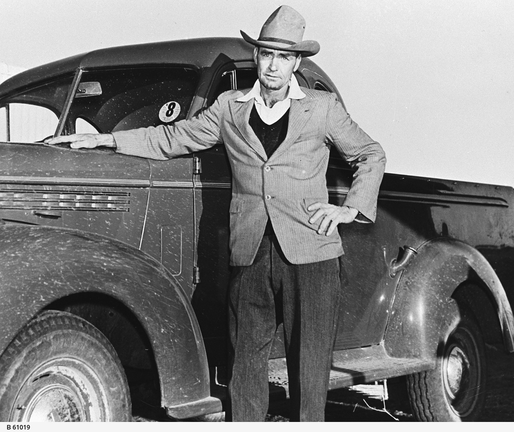 A man with an early model utility truck