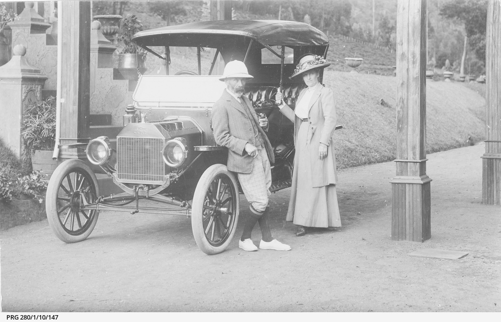 An early model Ford motor car and owners Mr & Mrs J.B. Tothill