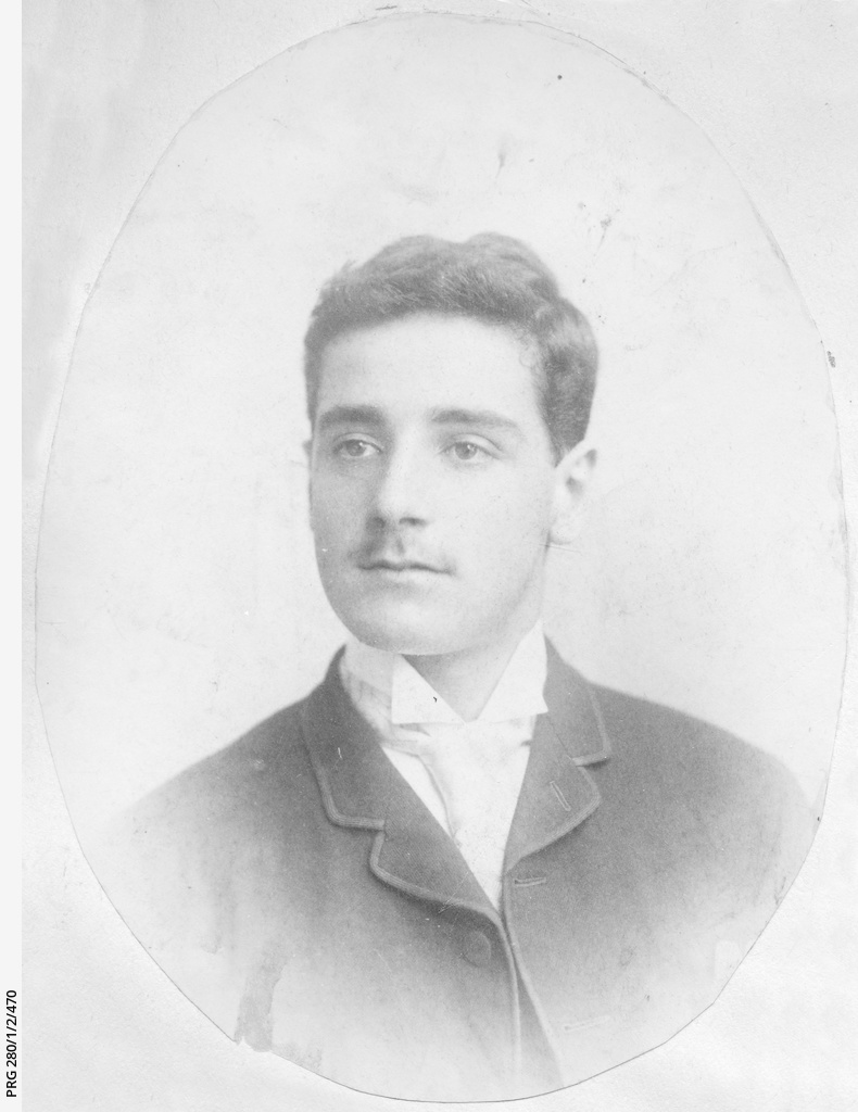 Head and shoulders view of a young man identified as Alphonse Collins
