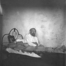 Man sitting up in bed