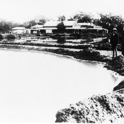 Two men inspecting the 1931 flood scene at Berri