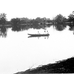 River scene at Waikerie with two women being rowed on the river
