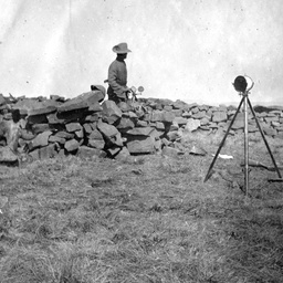 A soldier in the field during the South African War signalling with heliograph equipment