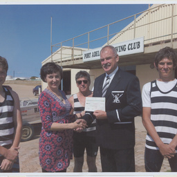 Labor Member for Port Adelaide, Susan Close, presenting a cheque to the Port Adelaide Rowing Club.