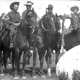 Military horsemen at a sports day