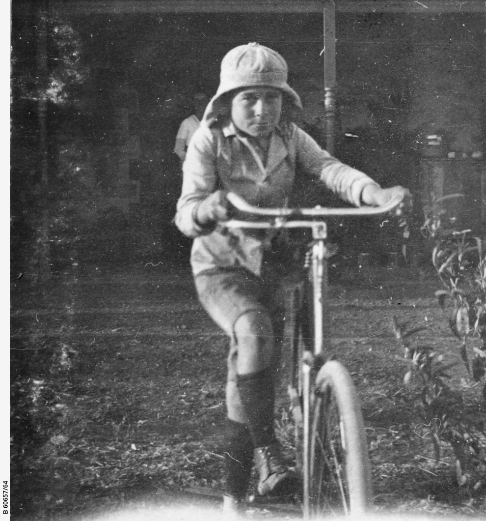 Young boy with a bicycle