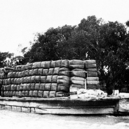 P.S. Colonel towing Moorabin barge loaded with wood bales