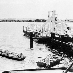 Children playing in small rowboats beside the Tailem Bend ferry