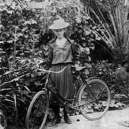Girl by a bike