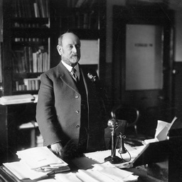 Arthur Searcy standing behind his office desk