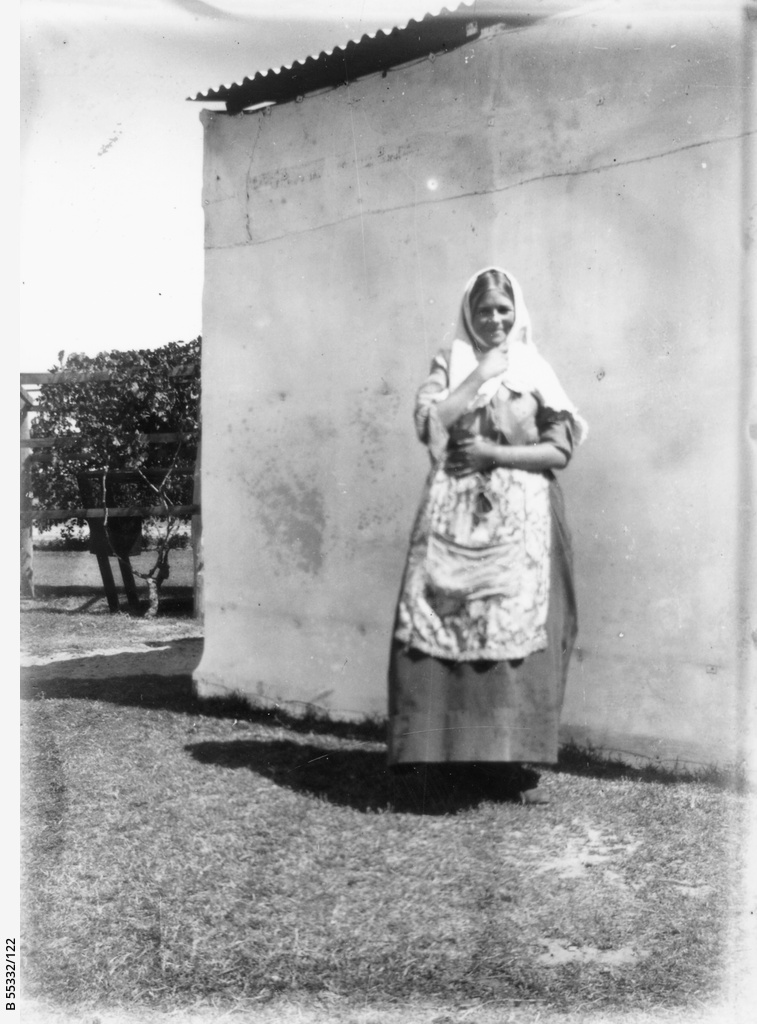 Young woman in front of wall