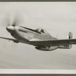 A68 Mustang in flight.