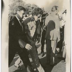 Policeman escorting a protester at the Vietnam War Moratorium rally
