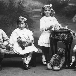 Studio portrait of four young children