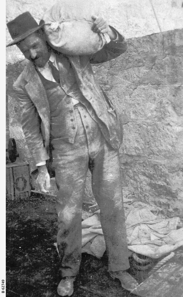 An employee carrying gypsum at Stenhouse Bay