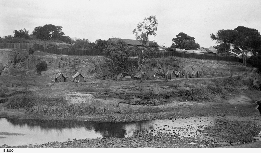 South Bank of the Torrens showing huts occupied by homeless men during the 1930 depression