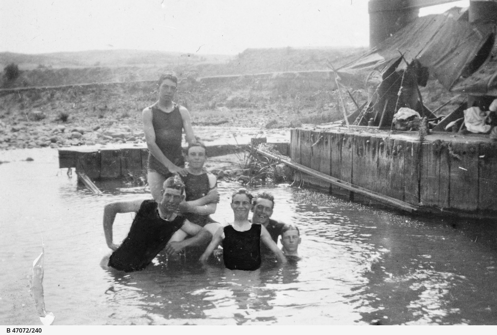 A group of boys in the Broughton River under the Yacka railway bridge