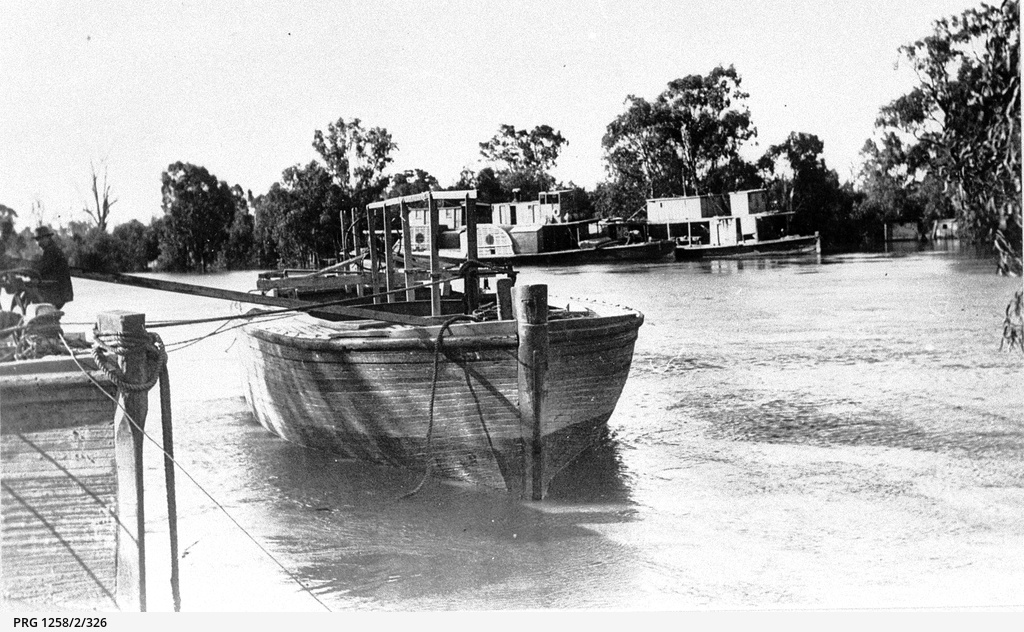 River boats and barges tied up at Echuca at high river level