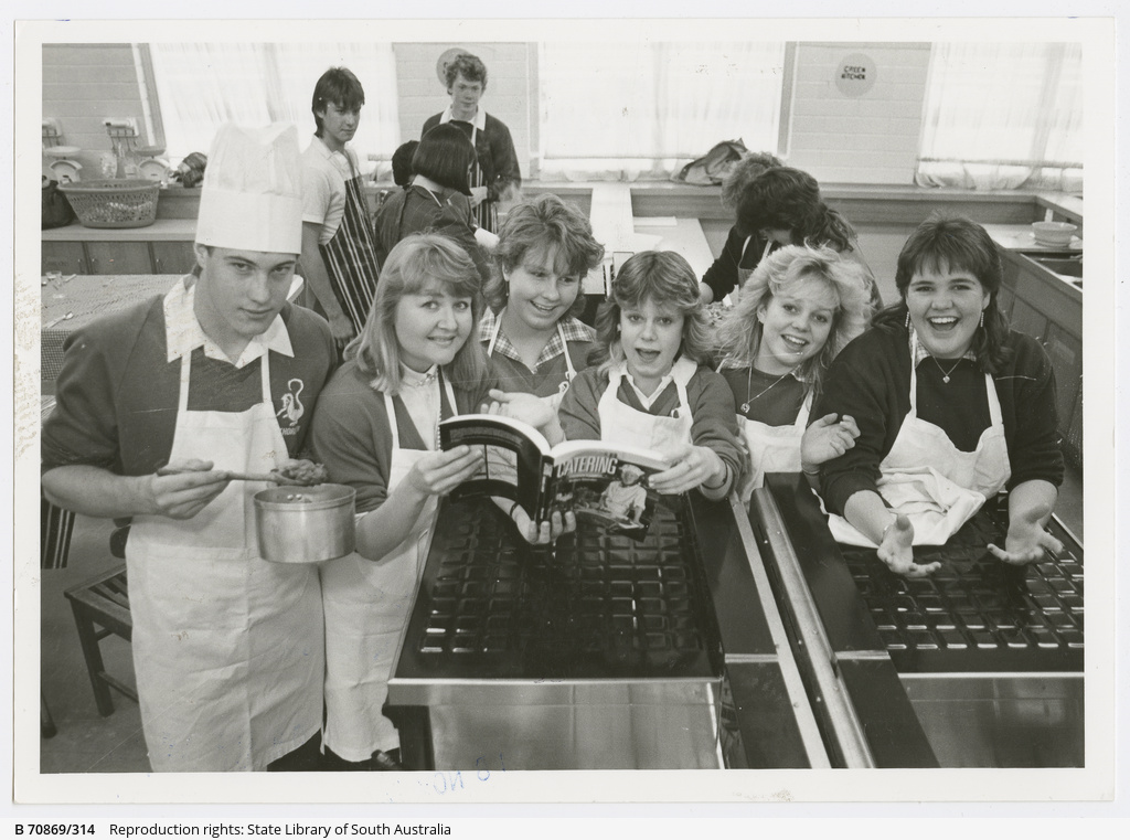 Teacher Robin Glaiser (second from left) with students Brett, 15, Tracey, 15, Kyle, 15, Renae, 16, and Vanessa, 15, pictured during the book launch at Thorndon High School's home economics department. 9 September 1987.